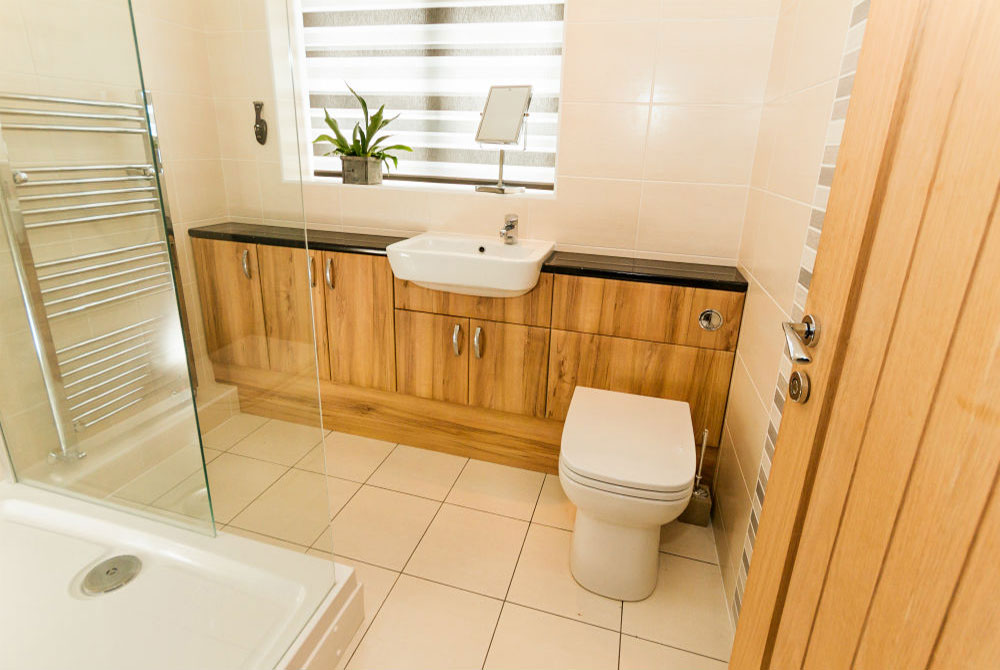 Image of a toilet, basin and cabinets
